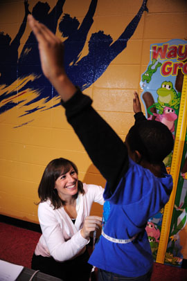 Picture of Abby Gamble working with students.